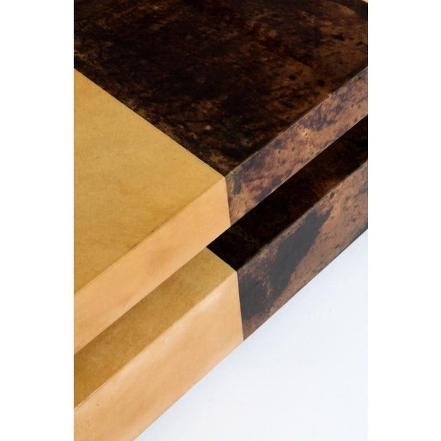 Post-modern two-tone coffee table by Aldo Tura. Lacquered parchment Italy, 1970s. The top slides open to gain extra...
