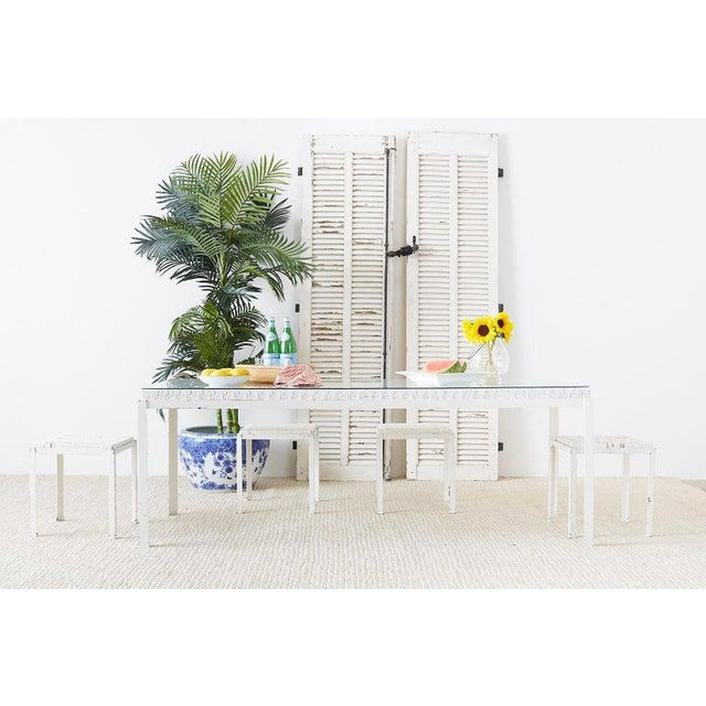 Chic California modern woven cane top dining table designed by Danny Ho Fong for Tropi-cal. Rare white finish with an iron...