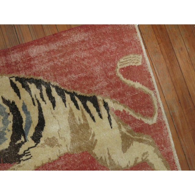 One of a kind, mid 20th-century Hand-knotted Turkish Anatolian Small Size Rug depicting a roaring tiger. Professionally...