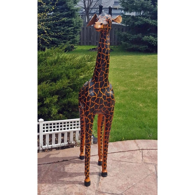 Add some major drama to your space with this five foot, hand-painted giraffe! This leather Giraffe sculpture is hand-...