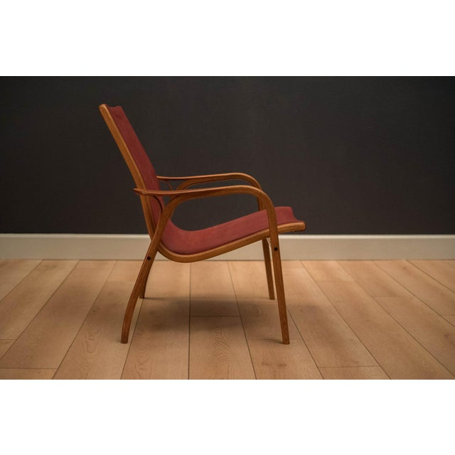 Mid-century low back Laminett lounge chair designed by Yngve Ekström for Swedese. This piece displays a sculptural oak...