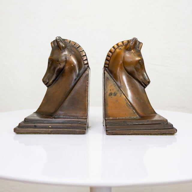 Art deco trojan horse bookends. Copper plated and heavily weighted. Their natural patina and wear is appropriate for this...