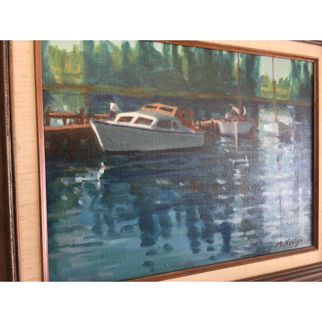Beautiful vintage painting by Napa California artist Henry E. McNeely. This oil on Belgian canvas depicts boats next to a...