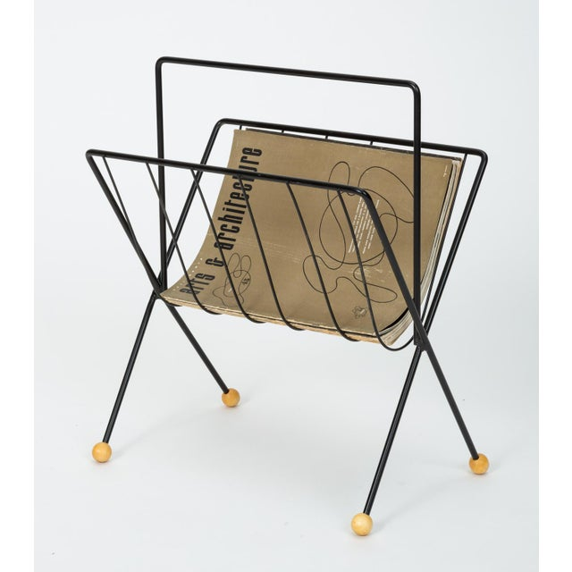 American made wire magazine rack by New York-based designer Tony Paul. The rack has a skeletal frame with bent spokes to...