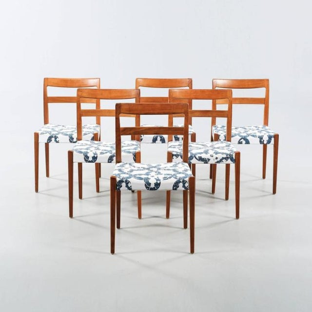 This set of six walnut chairs was designed by Nils Jonsson for Troeds, Bjarnum in the 1960s, and remains in an original...