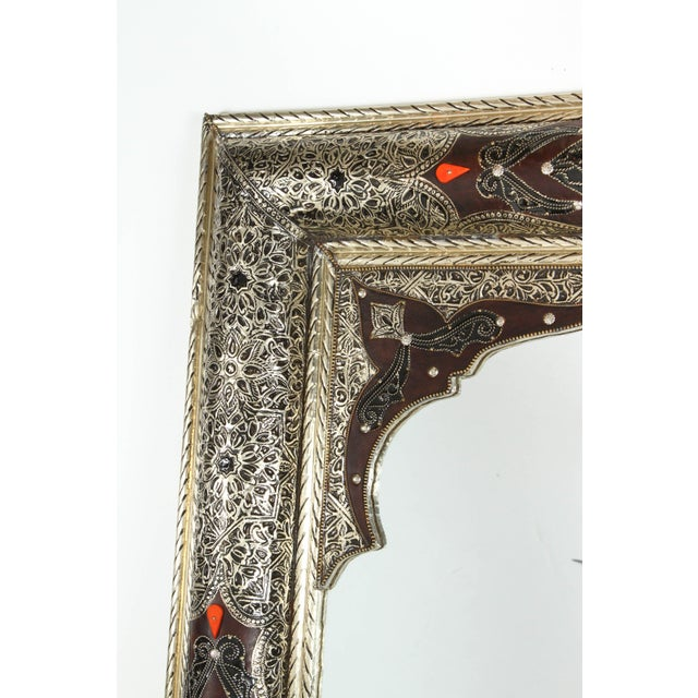 Pair of Elegant Moroccan mirrors decorated with silvered repousse metal delicately engraved and wrapped with leather and...