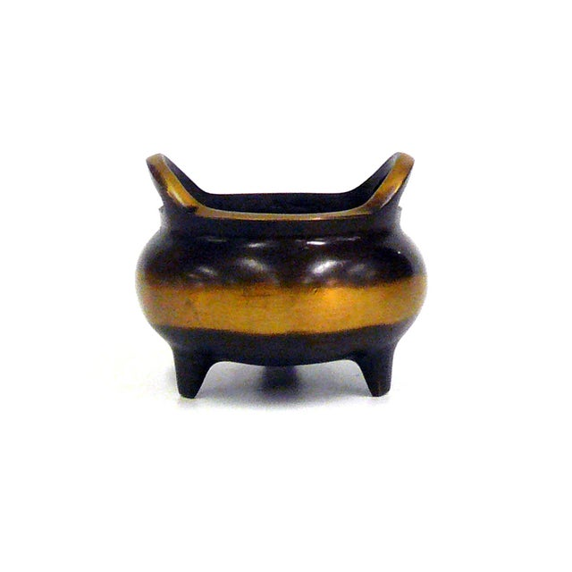 Bronze, Oriental incense burner featuring a fine polish. It can be used as incense holder, display accent, or decorative...