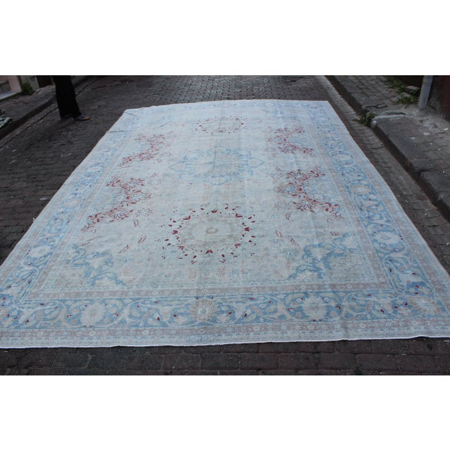 Vintage Tabriz Persian rug in hues of boysenberry, rose, deep sky blue and wheat. Rug has been shaved and hand distressed...