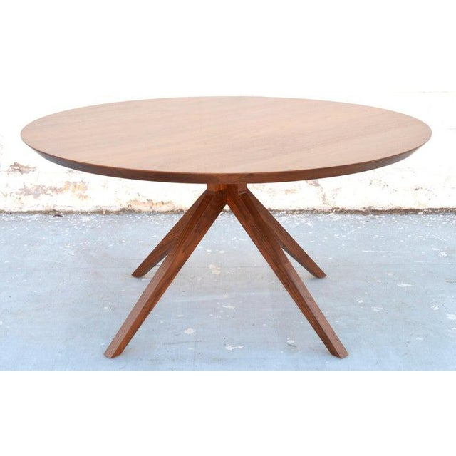 """Custom dining table in solid walnut. Shown here in in a 60"""" diameter and low sheen lacquered finish."""
