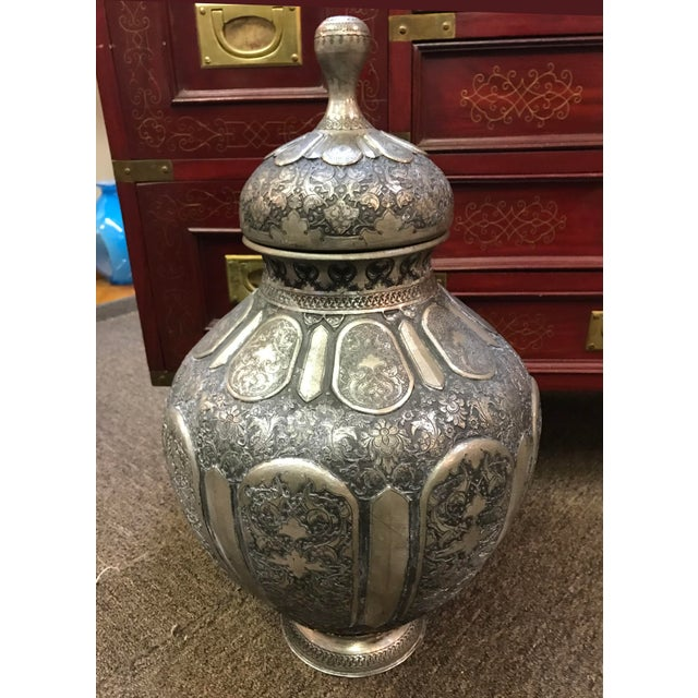Antique middle eastern hand chased silver urn with lid. Most likely from Persia.