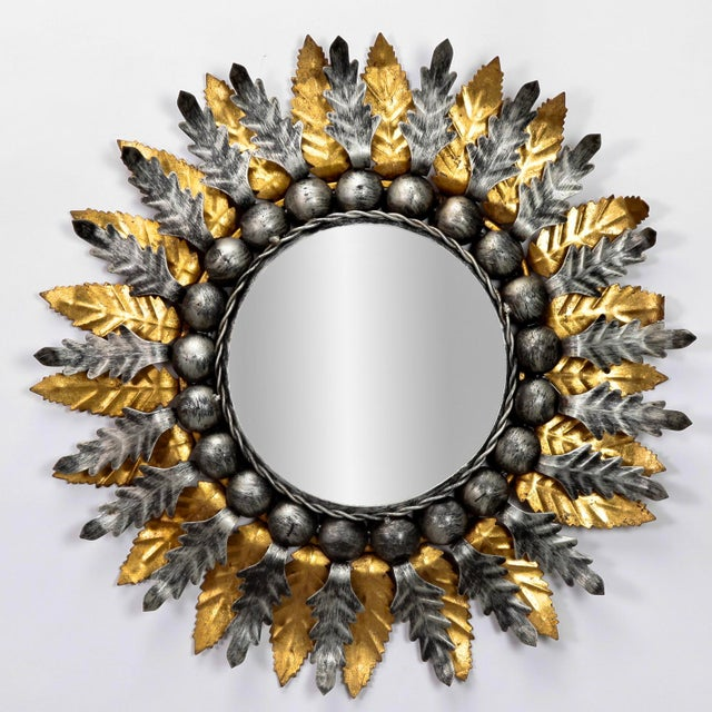 Pair of circa 1960s Spanish mirrors with metal sunburst form frames with silver and gilt finish. Sold and priced as a...