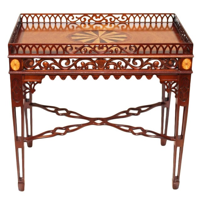This fine English mahogany tea table is fashioned in the Chinese Chippendale style and features elaborate pierced fretwork...