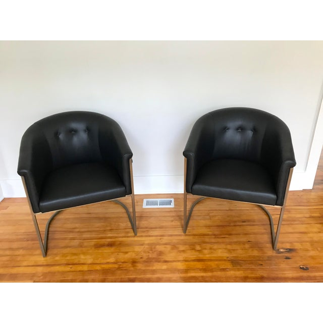 Brand new in box JLF Collections black leather barrel chairs with aged brass frames. They were made for a hotel lobby but...