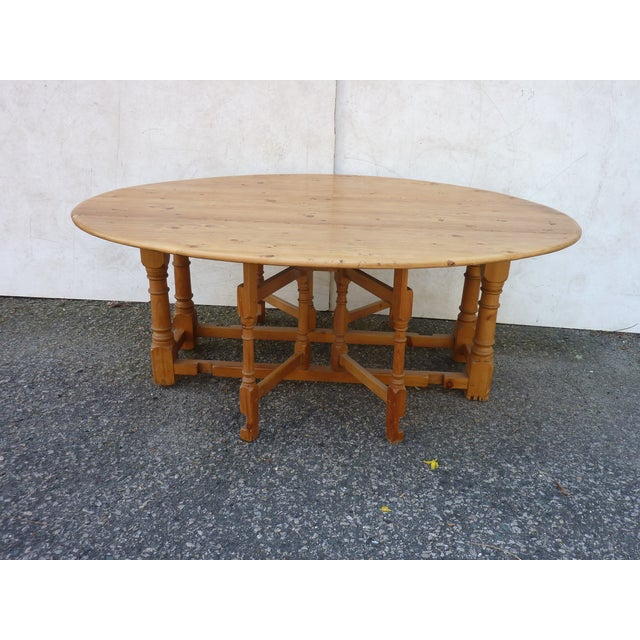 Scandinavian pine coffee table with turned legs, opens to a generous oval shape, well constructed with pegged joints, the...