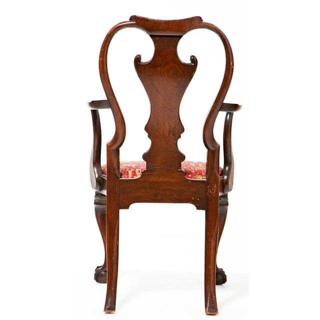 An English George I - George II armchair with ball and claw feet.