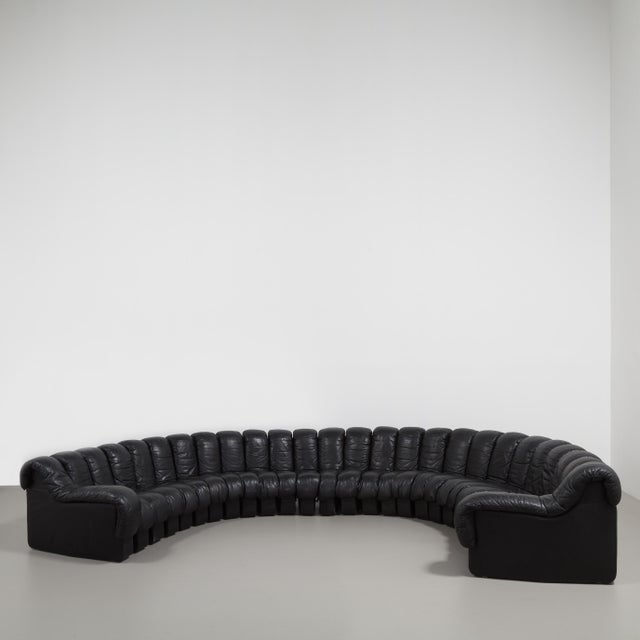 A 28 Piece Black Leather De Sede DS 600 Non-Stop Sectional Leather Sofa designed by Heinz Ulrich, Ueli Berger and Elenora...
