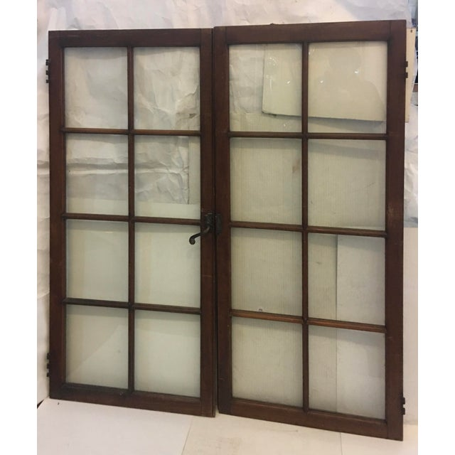 A beautiful vintage 19th Century Philadelphia walnut wood windows with the original brass hardware. A great architectural...