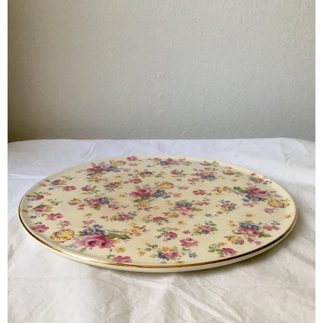 This charming serving plate is ideal for serving a large cake or a cheese selection It was made in the 1920's by Romarco...