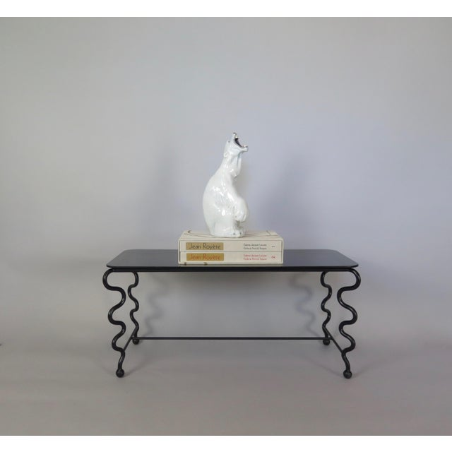 Chic, contemporary hand-forged 'Serpentine' coffee table by ODYSSEY gallery. Black wrought iron and black glass with...