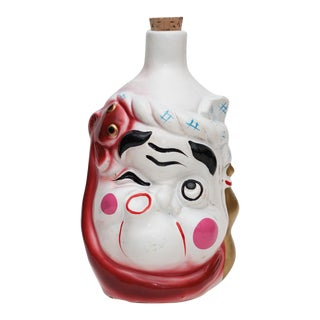 Late 20th Century Okame and Hyottoko Japanese Lacquered Ceramic Sake Bottle For Sale