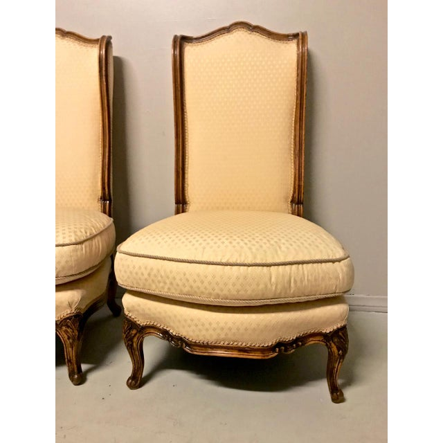 This is a super pair of French Louis XV-Style Chauffeuses--fireside or slipper chairs with down cushions--that dates to...