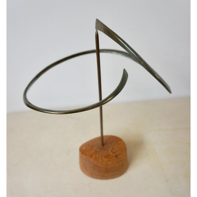 Kinetic sculpture in bronze by sculptor and jewelry artist, Russell Secrest (1935-2010). The solid hand-hammered bronze...