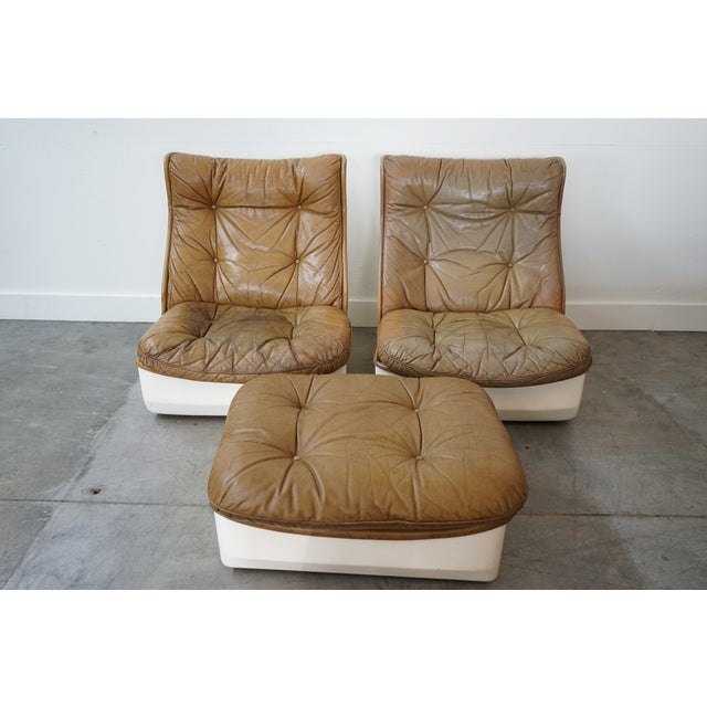 You're looking at a gorgeous set of French, mid-century chairs with single ottoman by French design firm Airborne...