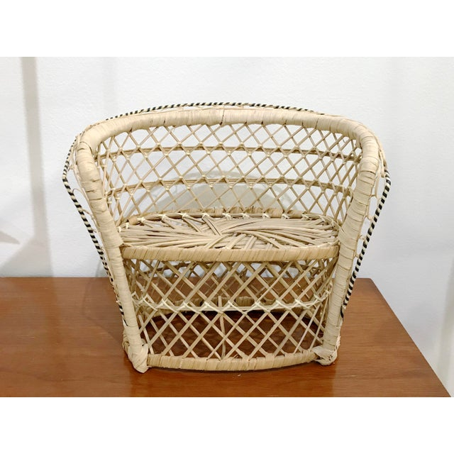 A delightful miniature Rattan Peacock Loveseat Chair. Just like the large scale chairs only smaller and perfect for plants...