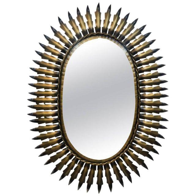 Spanish Gilt Metal Oval Sunburst Mirror For Sale