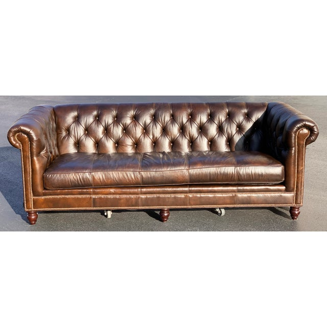This is a lovely Tommy Bahama tufted leather sofa. American made, quality furniture in almost new condition. Smoke free...