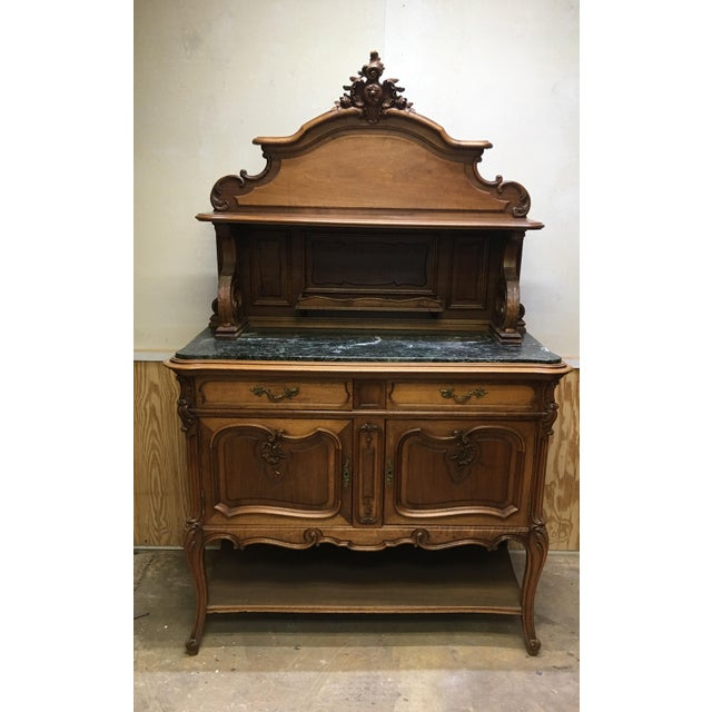 "Antique French server sideboard hand carved with marble top. This piece dates from the late 1800's to early 1900""s. It is..."