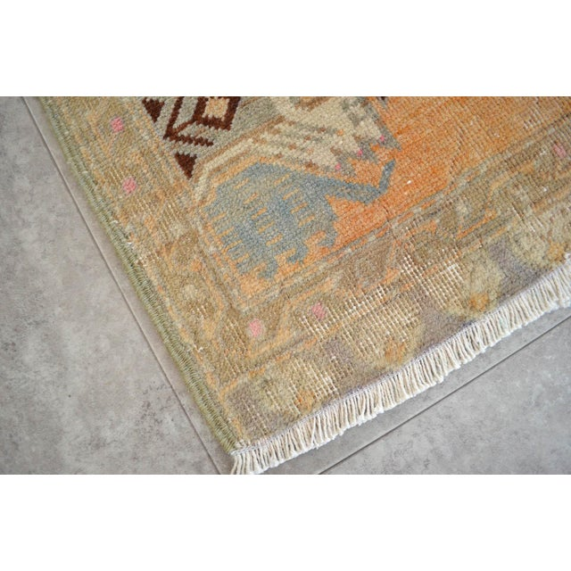 Vintage moderate orange (brown) background color yastik rug perfect for a small guest bath or in front of the kitchen sink...