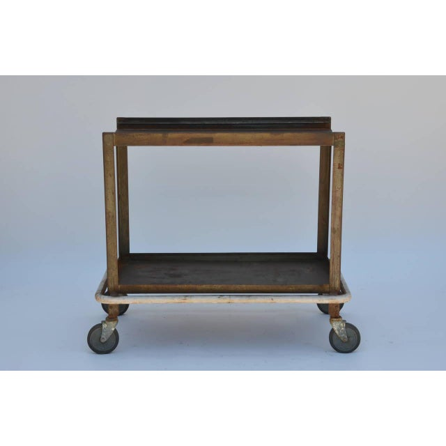 Sturdy Industrial Bar Cart on Wheels. Also great as an industrial console in the kitchen or anywhere else in the house.