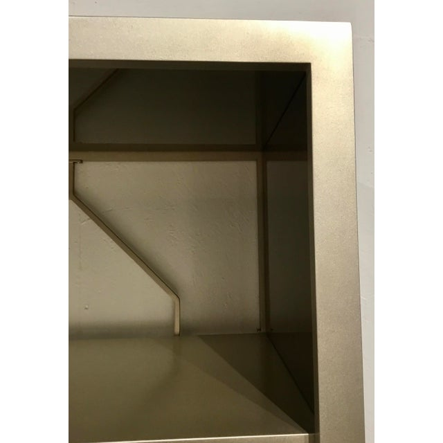 Original Retail $4040, Chippendale Style Caracole Modern Going up Display Cabinet, champagne finished wood frame and five...