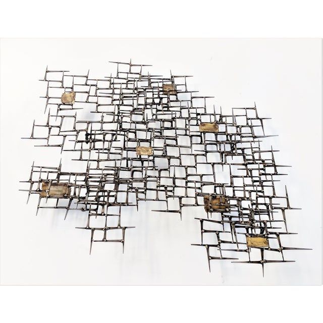 This sculpture is made of vintage cut masonry nails welded together with bronze. It is a multi-dimensional, layered piece...
