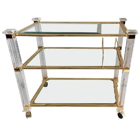 A vintage Lucite bar and serving cart on casters by designer Charles Hollis Jones with three tier glass tops inset against...