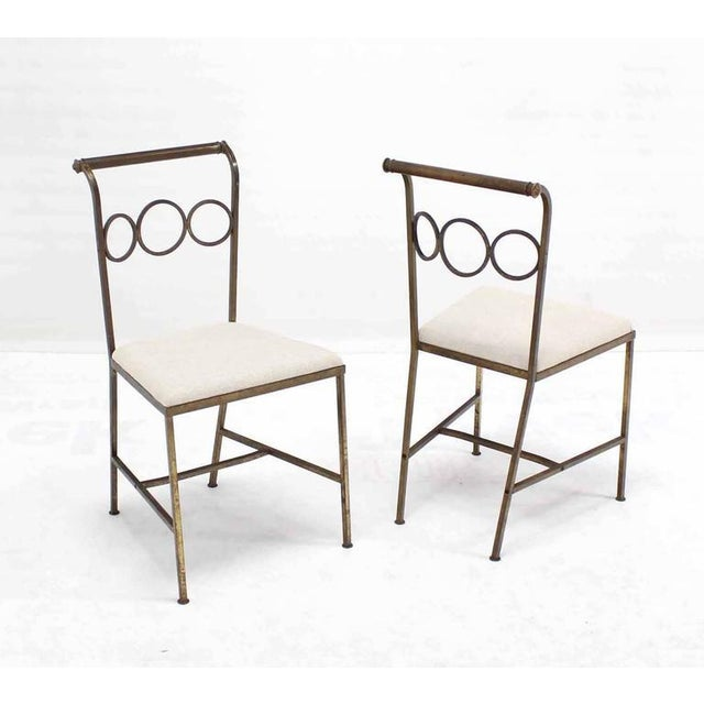 Set of rare design brass chairs in style of Jean Royère. Low profile HEAVY brass dining chairs.