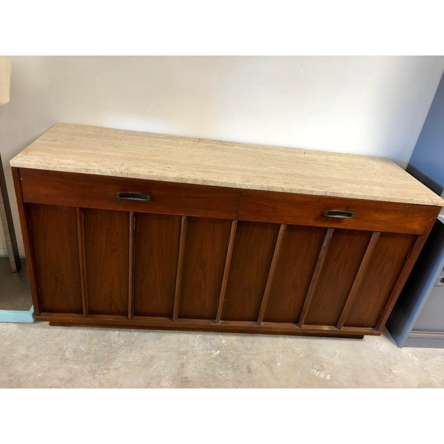 Plenty of storage. Can be used in dining room, below a wall mounted television, or even as record storage.