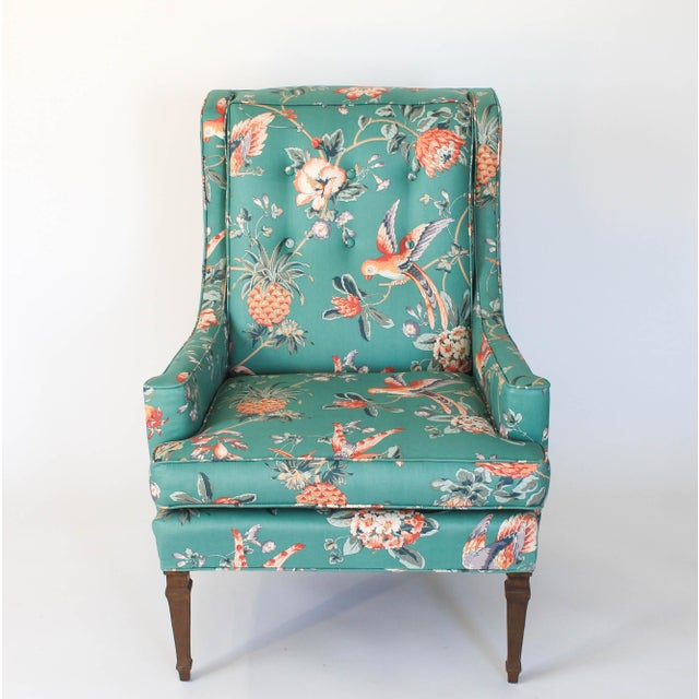 Colorful vintage upholstered chair with ottoman. The upholstery features birds and flowering motif. No makers mark. Stain...