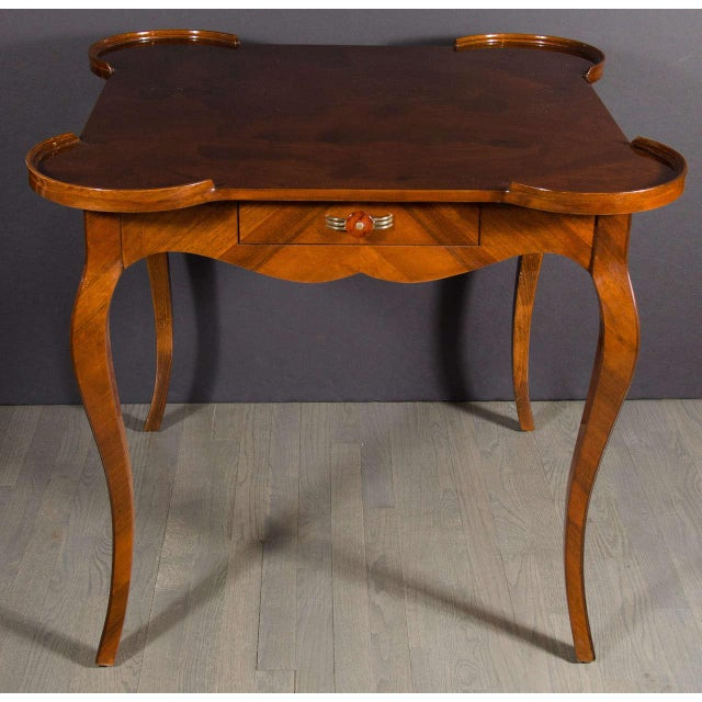Exceptional Art Deco game table in exotic burled walnut with splayed leg design, featuring one drawer with a streamline...