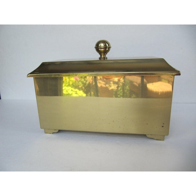 Shiny vintage brass lidded rectangle box. with ring handles on sides. Could be used to store remotes, for small items, or...