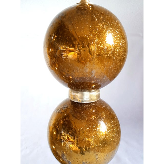 Pair of large gold mirrored Mid Century Modern Murano glass table lamps from Italy, 1970s. The hand made lamps have air...