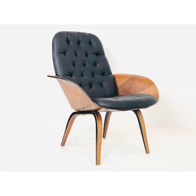 Bentwood armchair by George Mulhauser for Plycraft. There is some veneer damage near arm and back of chair but overall in...