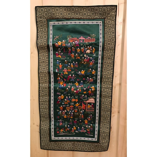 Colorful vintage wall hanging from the People's Republic of China. Fine embroidery in bright colors depicting Chinese...