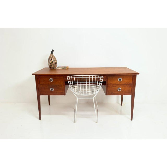 Handsome wooden desk with mega surface area. It has four drawers (two drawers on left, keyboard drawer on top and the two...