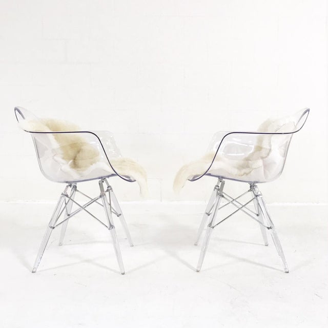 These lucite mid-century inspired arm chairs make oh so versatile pieces for any space in the home. We added soft...