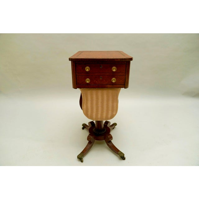 Circa 1820 Regency Amboyna Wood Worktable. Has fine ebony banding on the sides and drawer front and inlaid on the top....