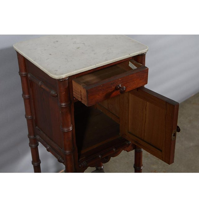 A very nice French victorian faux bamboo nightstand with marble top and lower shelf. This piece displays good...