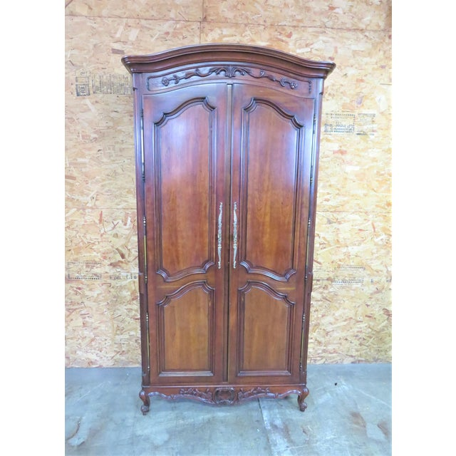 Century Furniture French Style Armoire with fully fitted interior , made of cherry with brass hinges and hardware