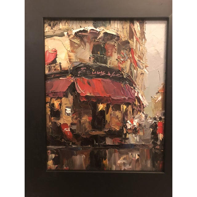 """This is an oil on canvas painting depicting a store front/street scene. The piece was made in the 1980s. Framed: 15.25""""H..."""